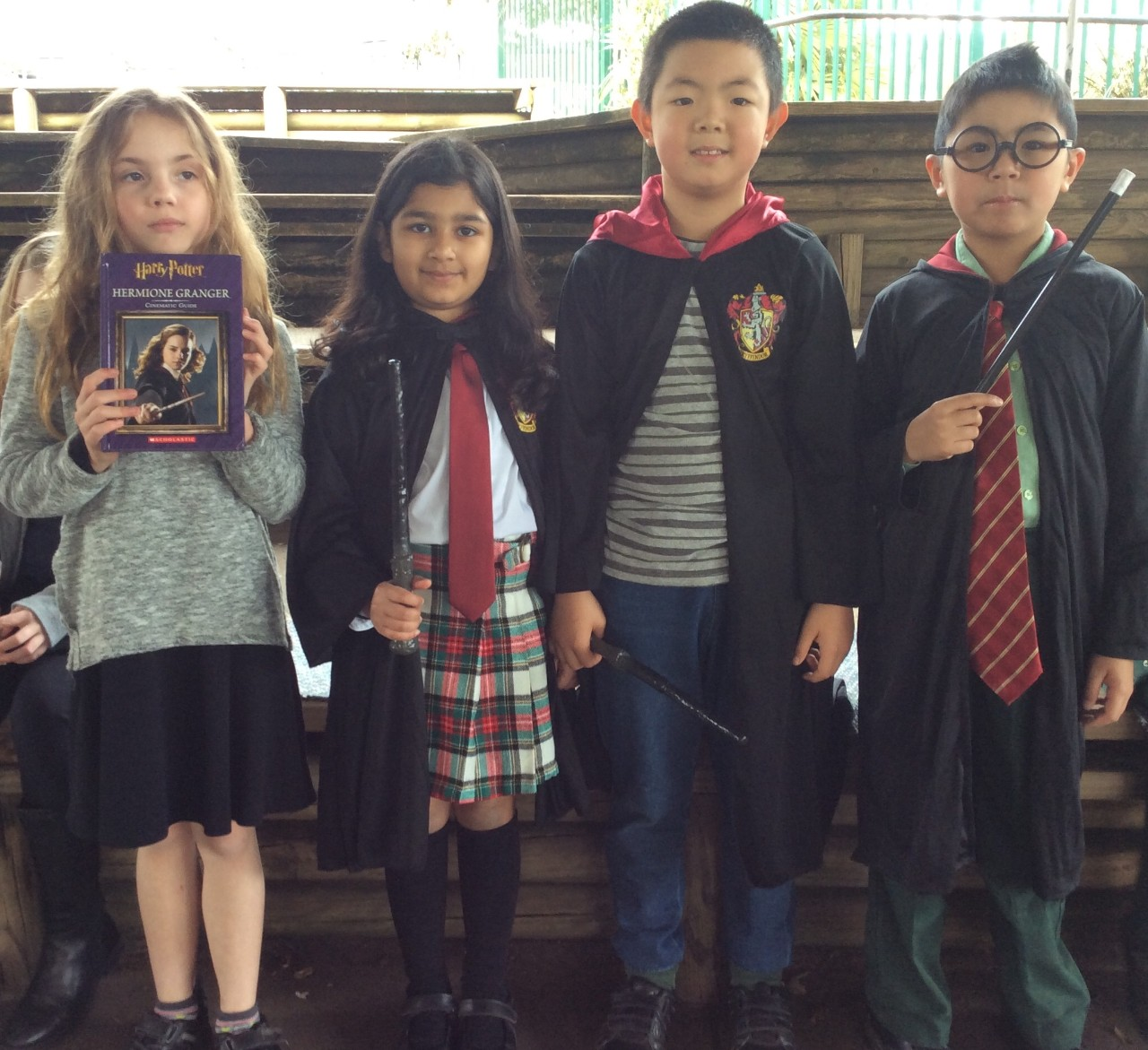 Four Year 2 students dressed in Harry Potter costumes at 2018 Book Parade