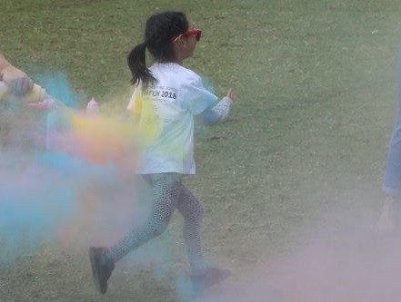 A student running through a colour station